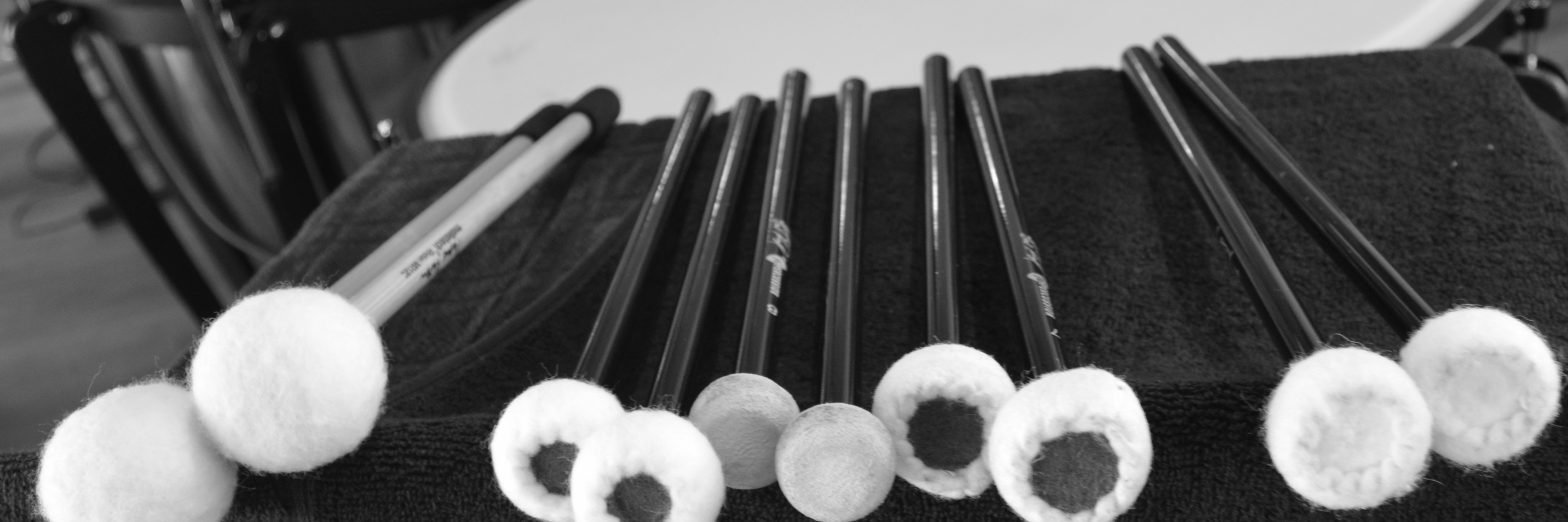 Image: Percussion mallets lying on stand in front of timpani (kettle drums)