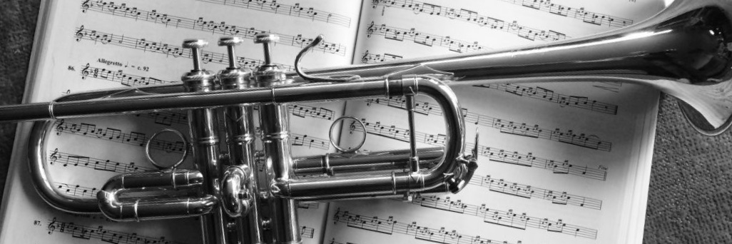 Image: C trumpet lying on sheet music
